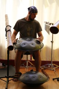 Jeremy Arndt performing his own compilations during a solstice yoga class at Just B Yoga in 2013.