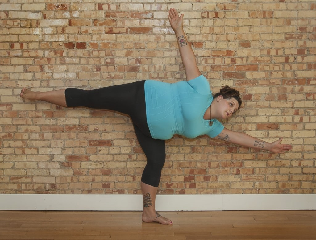 Connie Bonnie Perkins in half moon pose.