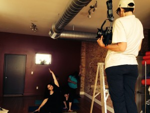 Photographer Roxanne Frith directs yoga students into poses for Just B Yoga photo shoot.