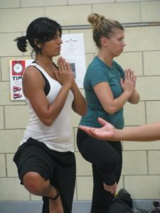 Anika, left, in a yoga class at the Shabazz Academy gym.