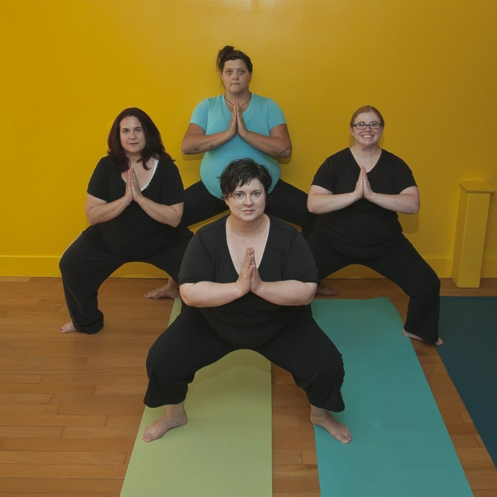 Yoga 2eXceL students in Buddha  Squat.