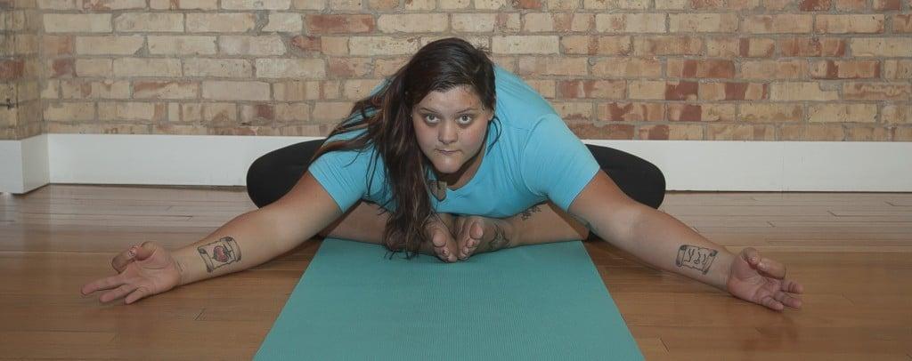 Connie Bonnie in baddha konasana yoga pose.