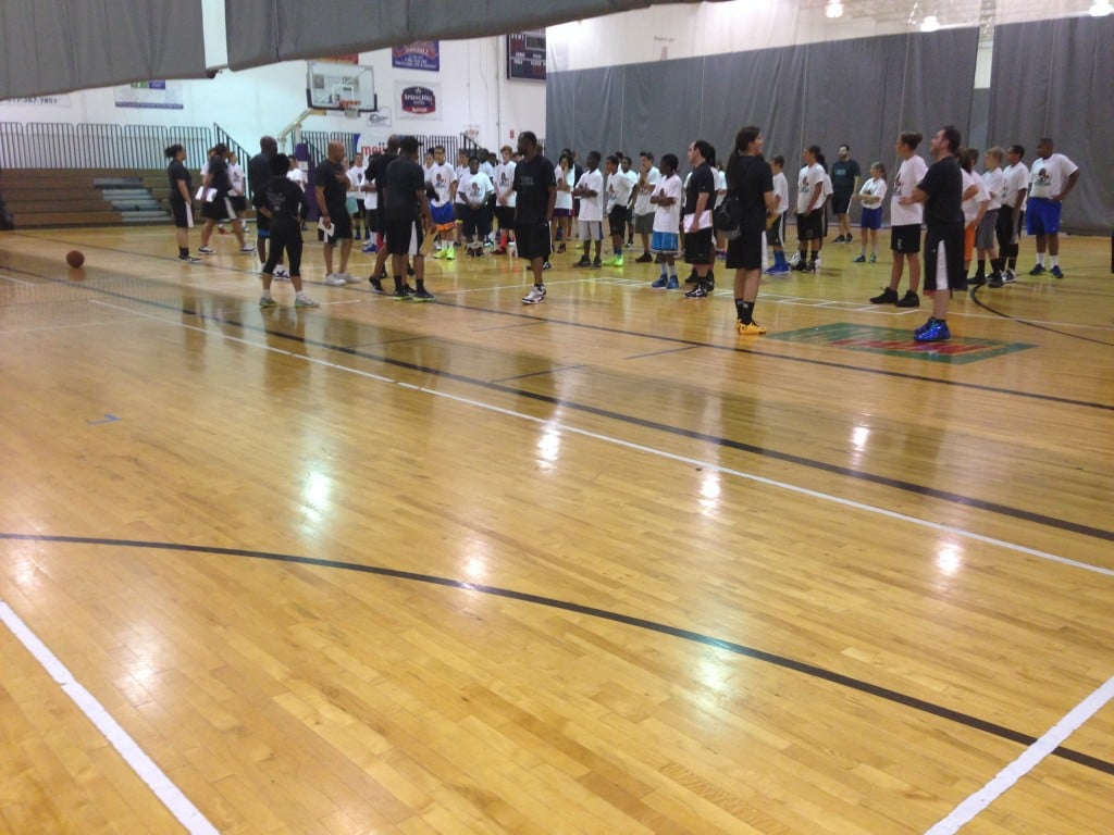 Players line up for the yoga at the Mateen Cleaves 1 Goal 1 Passion Basketball Camp.