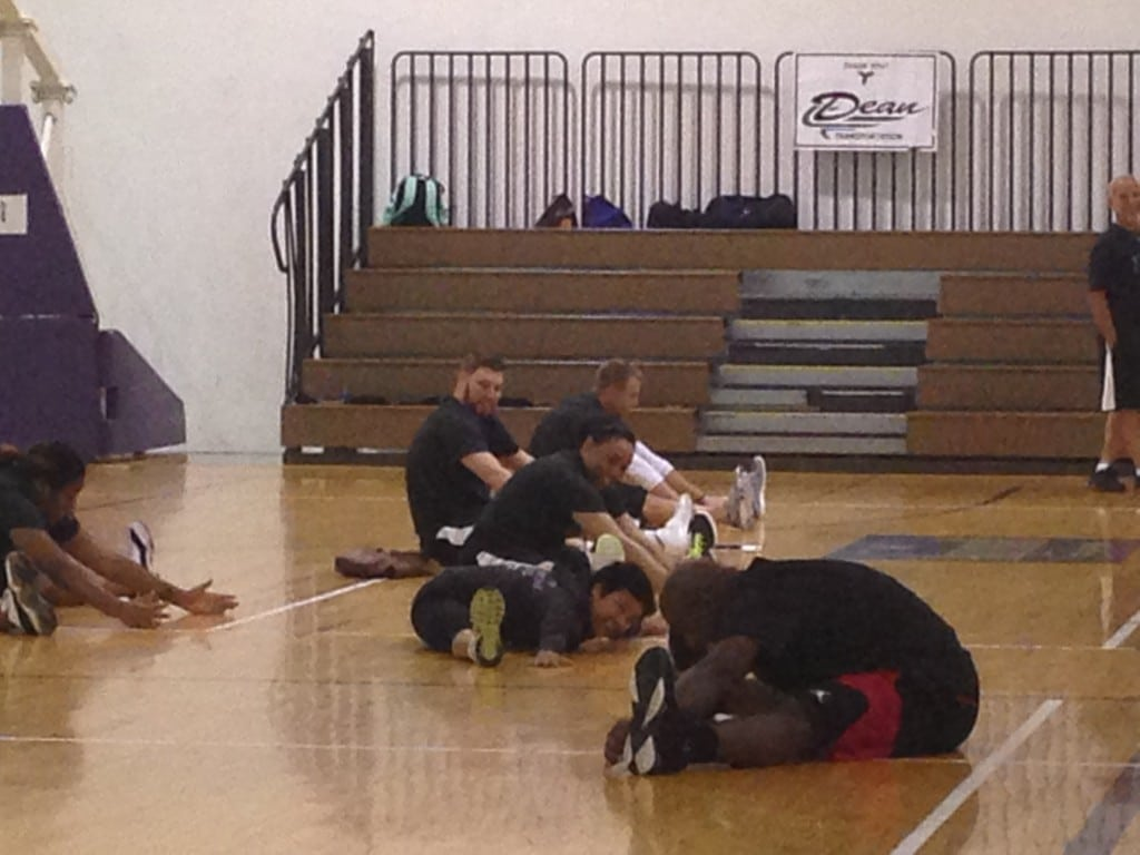 Mateen Cleaves doing yoga with Belinda from Just B Yoga at his 1 Goal 1 Passion Basketball Camp in Lansing.