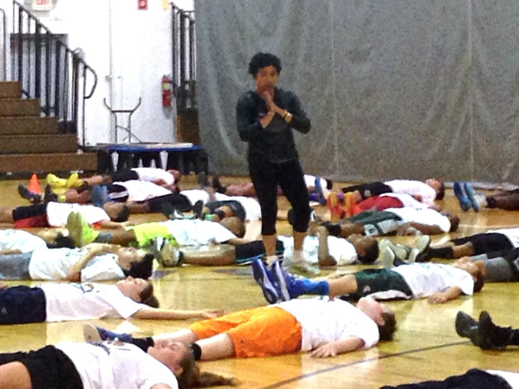Players in savasana at the Mateen Cleaves 1 Goal 1 Passion Basketball Camp in Lansing.