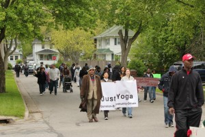 Just B Yoga participating in a march for peace after a surge in gun violence in Lansing in 2012.