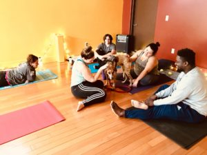 Caitlin, center rear, and Charlie, chatting after class at Just B Yoga last fall.